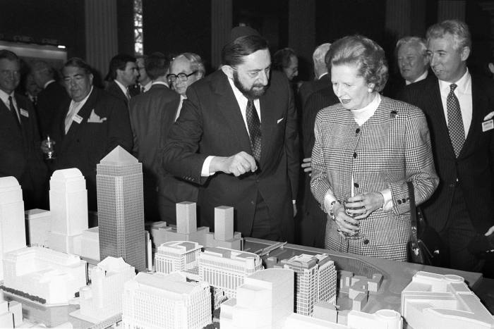 Margaret Thatcher, prime minister at the time, is shown a model of the Canary Wharf development