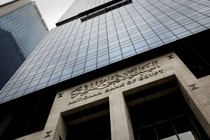 A logo sits outside the headquarters of the National Bank of Egypt in Cairo, Egypt, on Tuesday, Jan. 24, 2012.