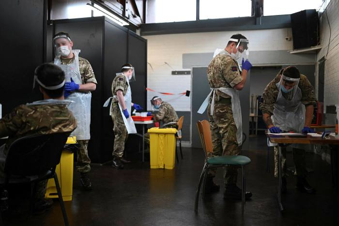 British Army soldiers staff a coronavirus testing centre in Liverpool, north-west England, on Tuesday