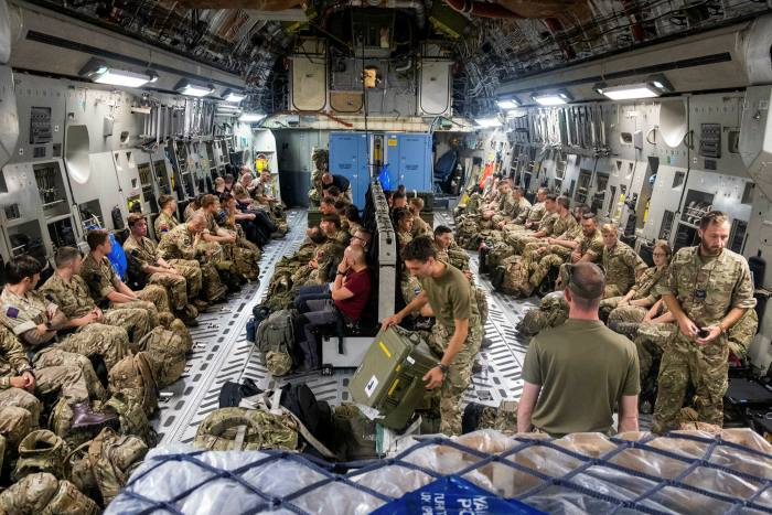 British soldiers from the Joint Force Headquarters prepare to be deployed to Afghanitan on Friday