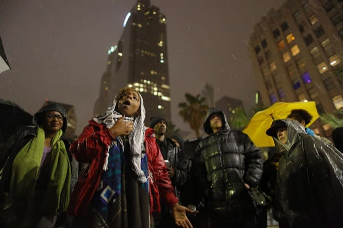 Patrisse Cullors addresses a protest after the fatal shooting of a homeless man by Los Angeles police in March 2015