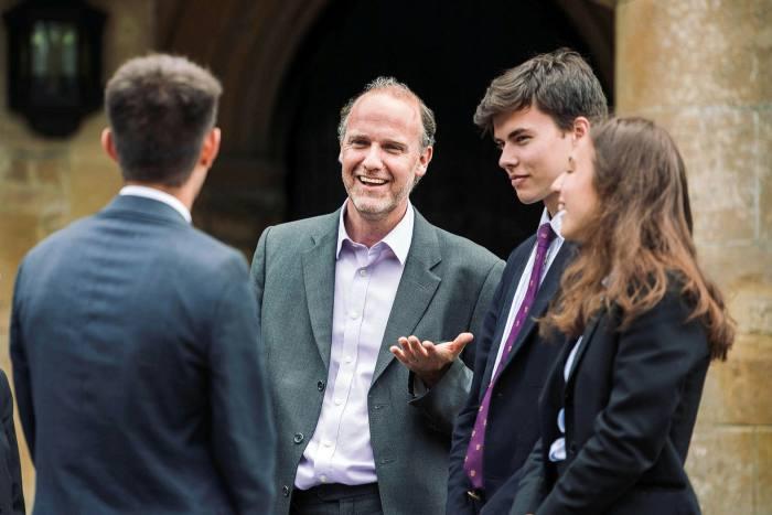 Students with Alex Peterken, headmaster of Charterhouse