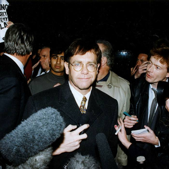 . . . and Elton John, leaving the High Court in 1993 after winning his libel case against the Sunday Mirror