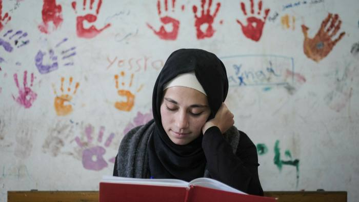 Refugee Zeinab al Awad, 18, works at a centre run by Relief & Reconciliation for Syria in northern Lebanon