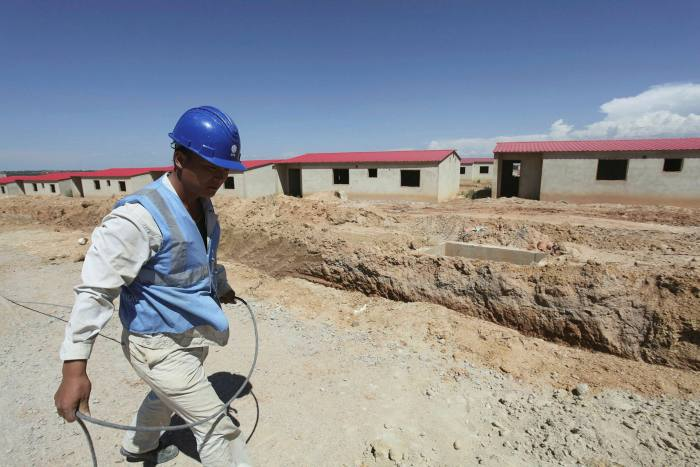 A Chinese worker walks past a construction site in Lubango. China is Angola's main creditor