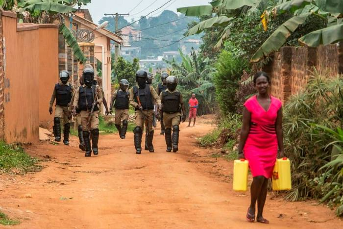 Security forces near Bobi Wine's house on Saturday. He remains under house arrest