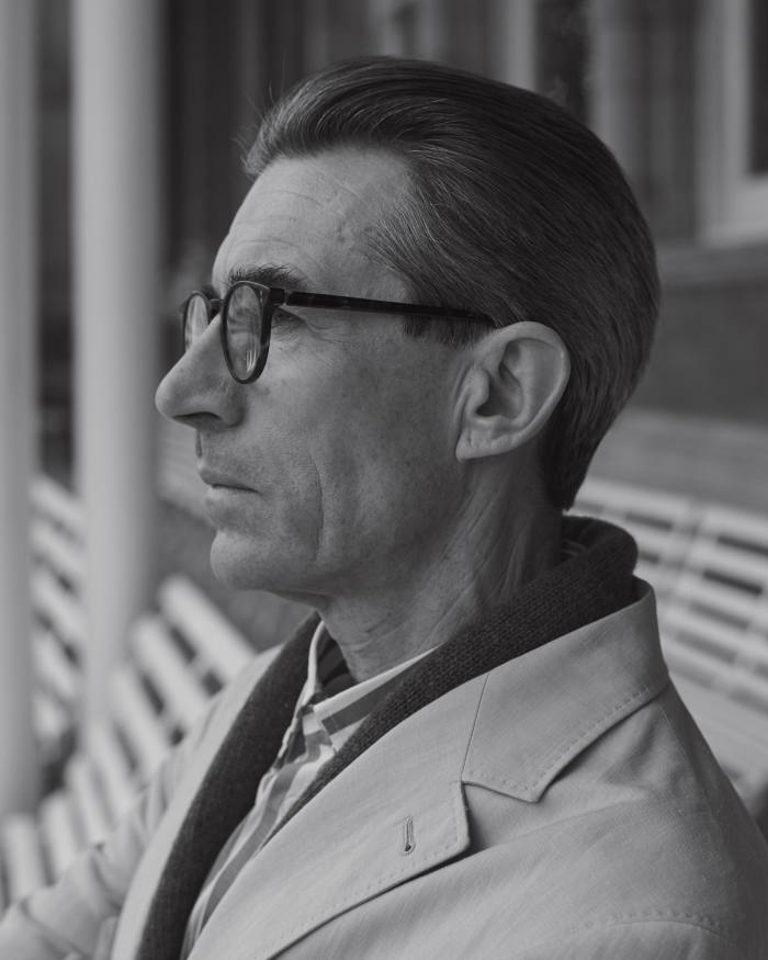 John wears Brunello Cucinelli linen suit, £3,150, and cotton shirt, £360. Anderson & Sheppard lambswool cardigan, £345. Glasses, model's own
