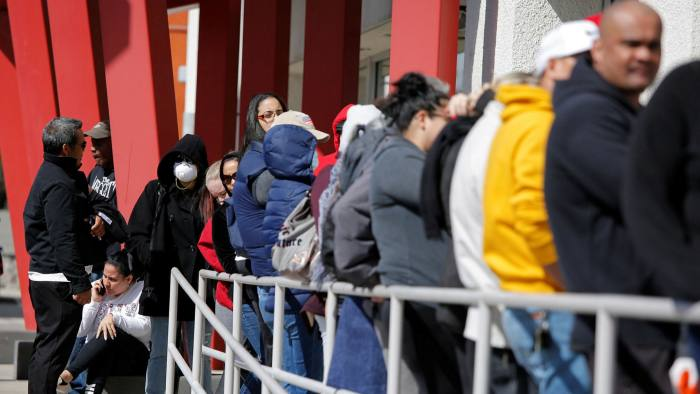 People wait in line for help with unemployment benefits at the One-Stop Career Center in Las Vegas, Nevada