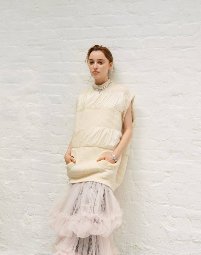 Louis Vuitton wool/polyamide pullover, €2,200, silk/polyamide tiered skirt, €3,600, and white-gold anddiamond LaStardu Nord necklace and bracelet