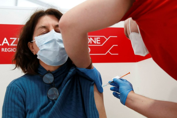 A health worker administers a dose of the Johnson & Johnson vaccine at a jab centre near the University of Rome Tor Vergata