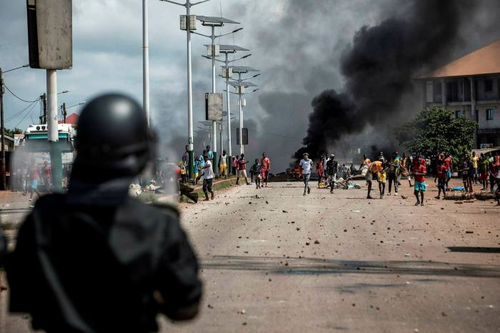 Protesters confront police in Conakry, Guinea, after 82-year-old President Alpha Condé was declared the winner of this month's election