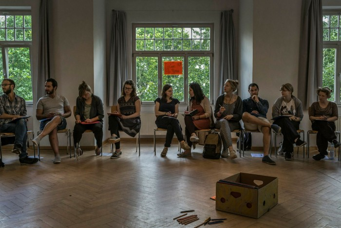 Refugees and Germans attend an integration seminar in Weimar in 2016
