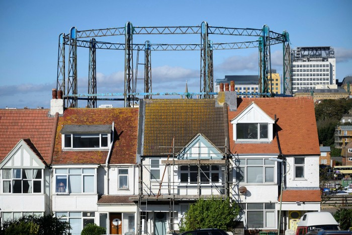 A disused metal gasometer towers over houses in Brighton, East Sussex