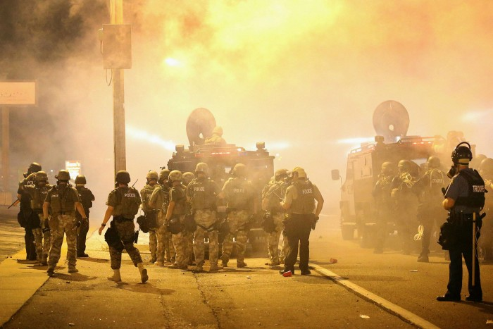 Police advance through tear gas during a protest at the killing of Michael Brown in Ferguson, Missouri, in 2014. The teenager's death at the hands of a white police officer sparked a summer of unrest