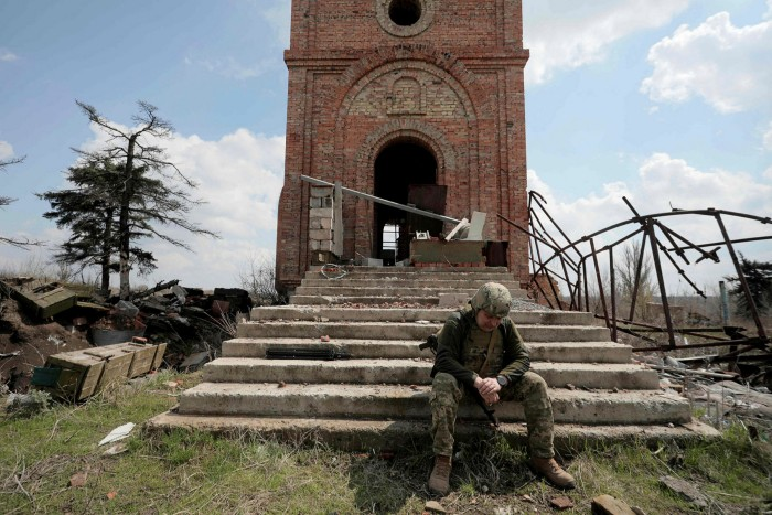 A Ukrainian soldier near the front line in the town of Pisky, near Donetsk