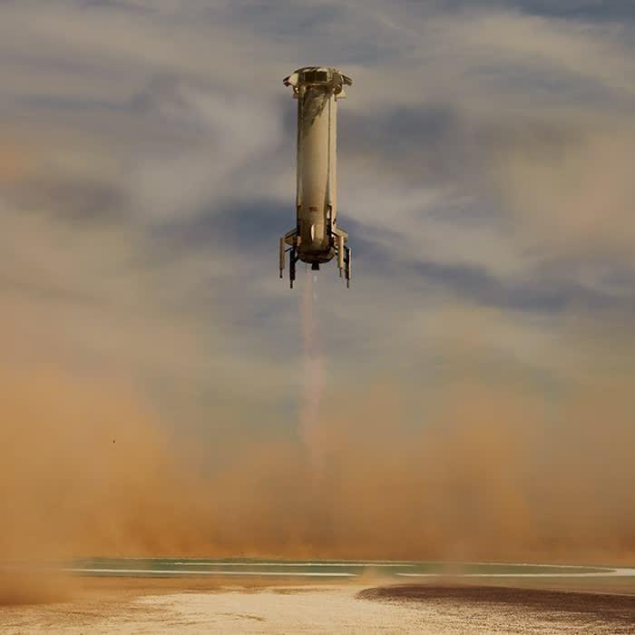 New Shepard booster rocket lands  - https 3A 2F 2Fd1e00ek4ebabms - Jeff Bezos's Blue Origin says it will take a civilian to space in July