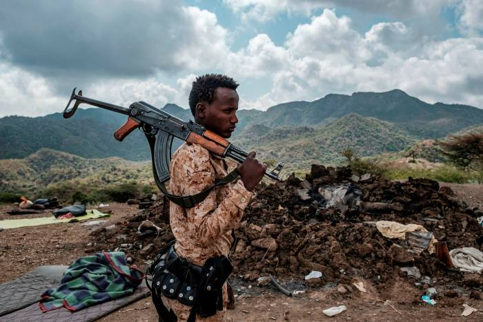 An Ethiopian government fighter outside a Tigray village in the aftermath of a clash with local forces
