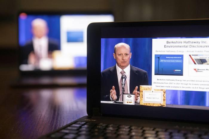 Greg Abel footage on laptop screens