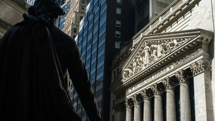 A statue of George Washington near the New York Stock Exchange. The US federal debt binge, which extends to many US companies too, is encouraged by expectations of very loose monetary policy over the longer term