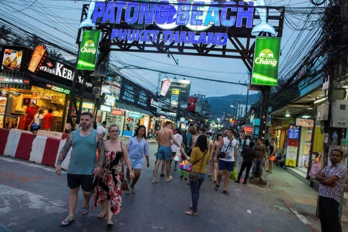 Tourists walk along Bangla road in Patong, Phuket, Thailand