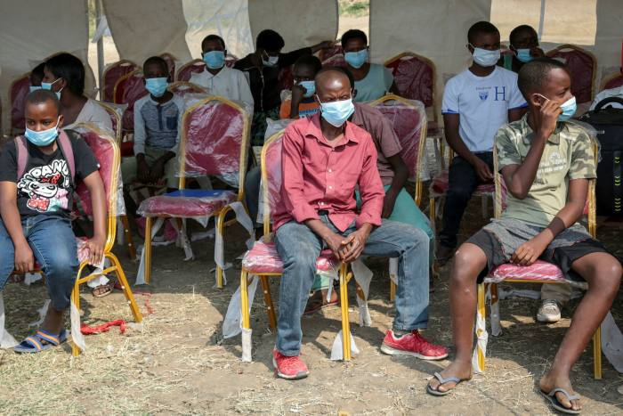 Residents in Bujumbura, Burundi, wait to be tested for Covid-19