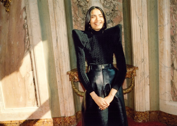 Balenciaga velvet Pagoda turtleneck, £1,250, and nappa leather Front Kick skirt, £2,850. Chain and ring, model's own