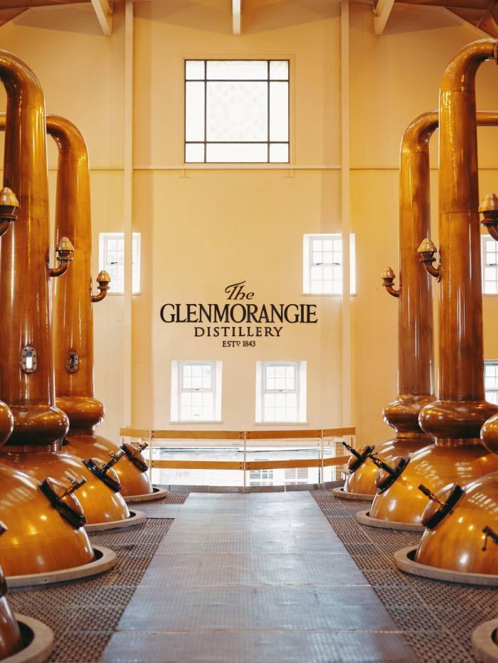 The wash and spirit stills in the Still House at Glenmorangie Distillery