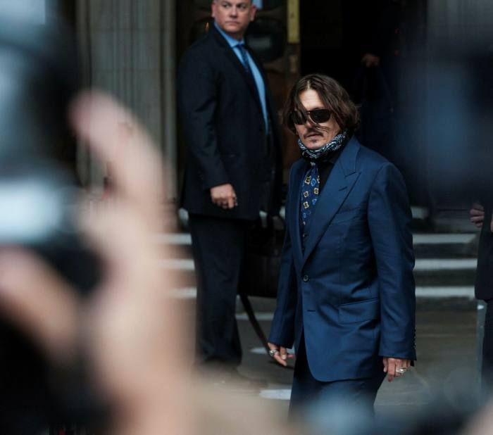 Depp arrives at the Royal Courts on the third day of the hearing: 'Both sides are likely to have spent several million pounds on lawyers'