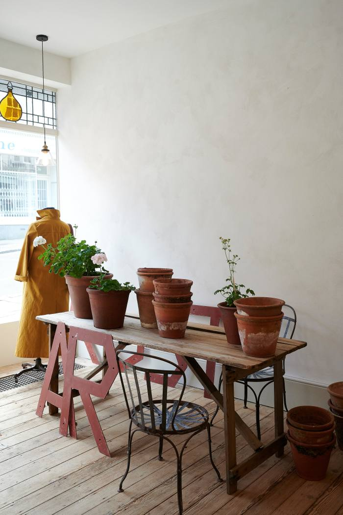 Old terracotta plant pots, antique chairs, and dry-waxed duster coat, £240