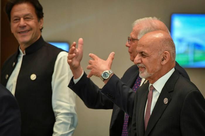 At the summit held in Uzbekistan last week, Afghan President Ashraf Ghani (right) and Pakistani Prime Minister Imran Khan (left)