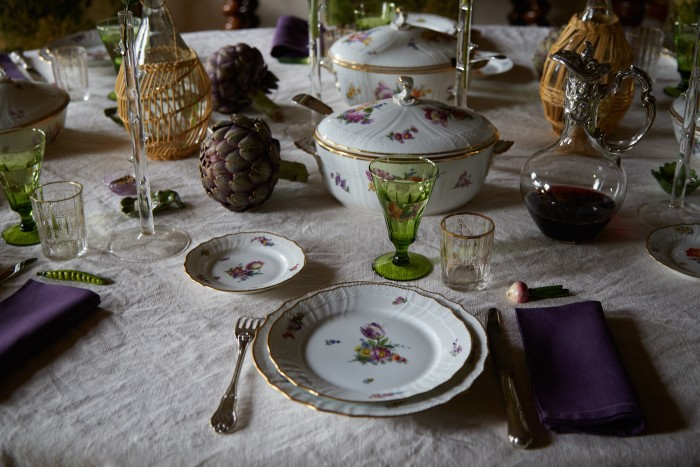 The dining table laid with vintage glasses and a Royal Copenhagen dinner service