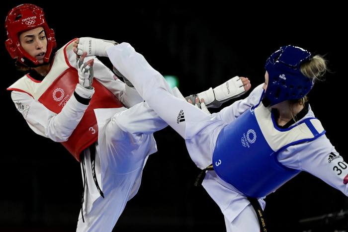 Britain's Jade Jones, right, and and Refugee Olympic Team's Kimia Alizadeh Zenoorin compete in the taekwondo women's under-57kg competition