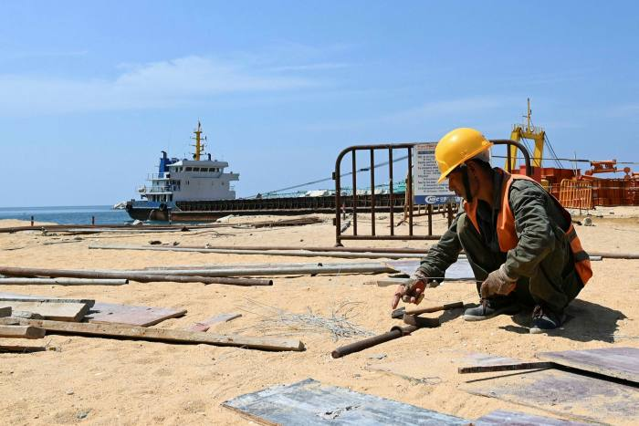 A labourer works at a construction site that is part of a Chinese-funded project for Port City in Colombo, Sri Lanka, under the Belt and Road Initiative