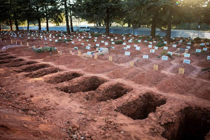 Graves in Westpark Cemetery, Johannesburg, where intensive care wards are overflowing