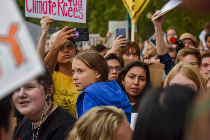 Thunberg with other young climate activists during a protest at the White House in September 2019