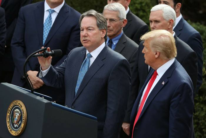 Quest Diagnostics chief executive Steve Rusckowski (centre) at a White House news conference in March, when President Donald Trump (right) announced a national emergency in reaction to the coronavirus pandemic