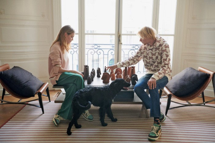 Vodianova and her son Lucas Portman playing chess, wearing Fashion Baby trainers (available on Wanna Kicks)