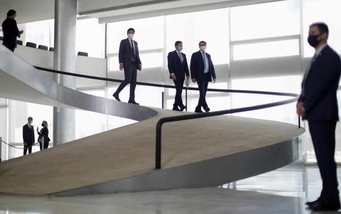 Bolsonaro on his way to give a statement about the emergency financial aid by the federal government during the coronavirus  crisis at the Planalto Palace in Brasília last week