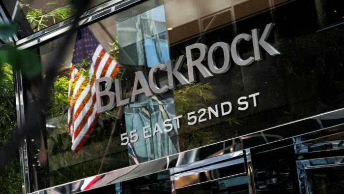 Signage is displayed at the entrance to BlackRock's headquarters in New York