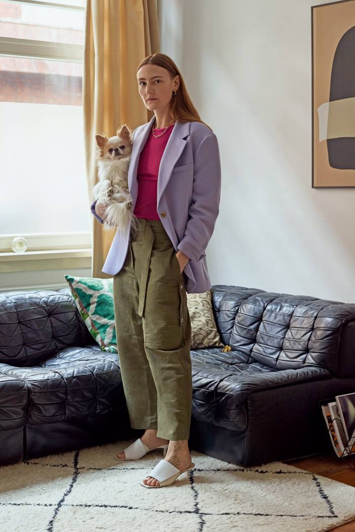 Fashion designer Elza Wandler at home with her chihuahua Billy