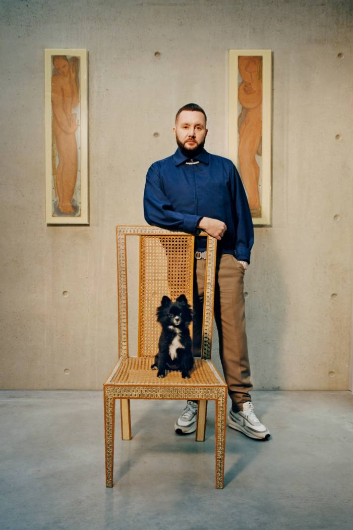Kim Jones, artistic director of Dior Homme and artistic director of Fendi womenswear and couture, at home in London with his Pomeranian named Cookie, one of his four dogs
