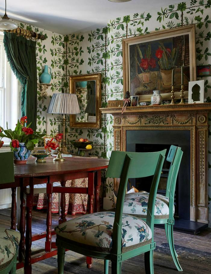 Gavin Houghton's dining room-cum-kitchen with wallpaper that gives a treehouse effect