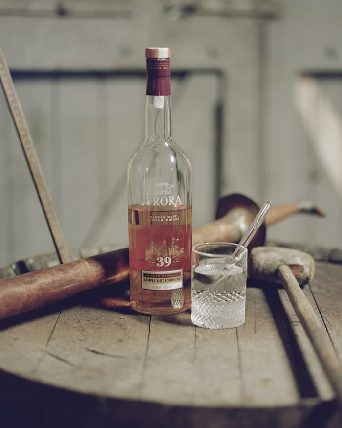 A bottle of 39-year-old Brora single malt on a wooden table