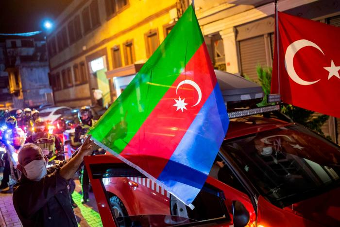 Cars display Turkish and Azerbaijani flags during a rally in Istanbul held to show solidarity with Azerbaijan in its conflict with Armenia