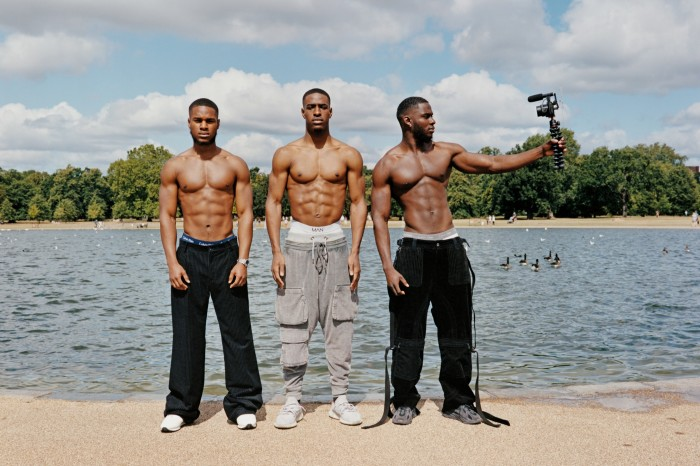 Dennis Fagbemigun, left, personal trainer, wears Dolce & Gabbana velour-mix trousers, £1,400. Trunks, model's own. Mallet Diver low-top trainers, £165. Watch, model's own.Nosa Okonedo, middle, model and YouTuber, wears Dolce & Gabbana cotton/silk-mix trousers, £875. Trunks, model's own. Adidas Originals Ozweego trainers, £90.Moses Ldn, right, personal trainer, wears Dolce & Gabbana velour-mix trousers, £1,400. Trunks, model's own. Adidas Originals Ozweego trainers, £90