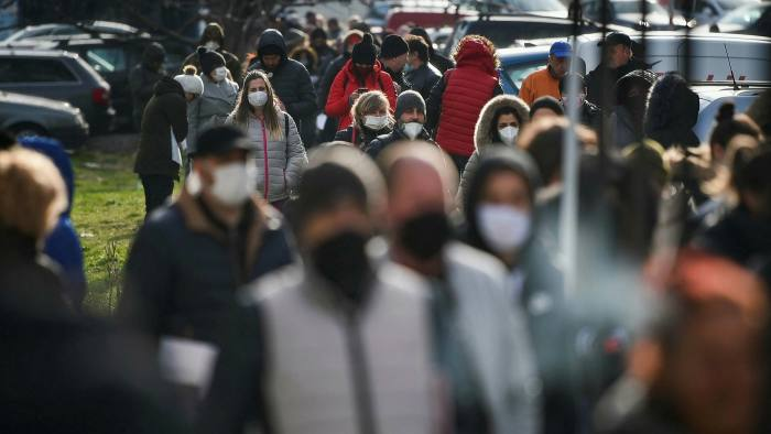 People wearing protective masks queue to register as unemployed in Sofia, Bulgaria. Government deficits are rising as the economic toll of coronavirus grows.