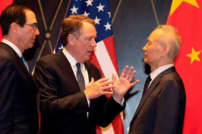 US trade representative Robert Lighthizer, centre, talks with Chinese vice-premier Liu He, right, as US Treasury secretary Steven Mnuchin looks on during trade talks in Shanghai in 2019