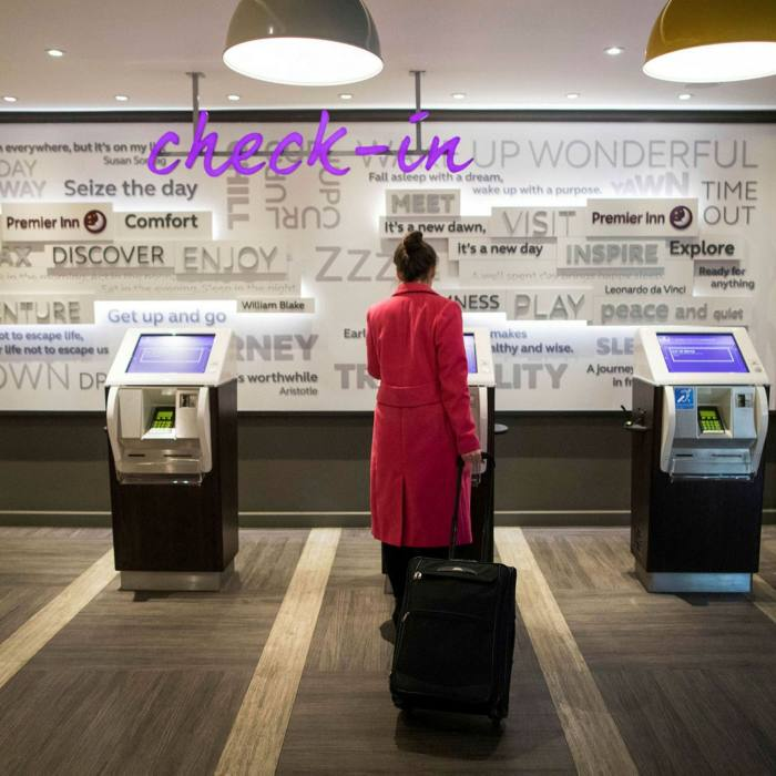 A guest uses the self service check-in at a Premier Inn hotel, operated by Whitbread. In May, Whitbread renegotiated covenants on its plentiful credit