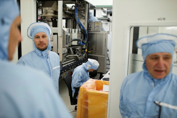 Workers at ASML, which produces the most advanced lithography machines used in the chipmaking process