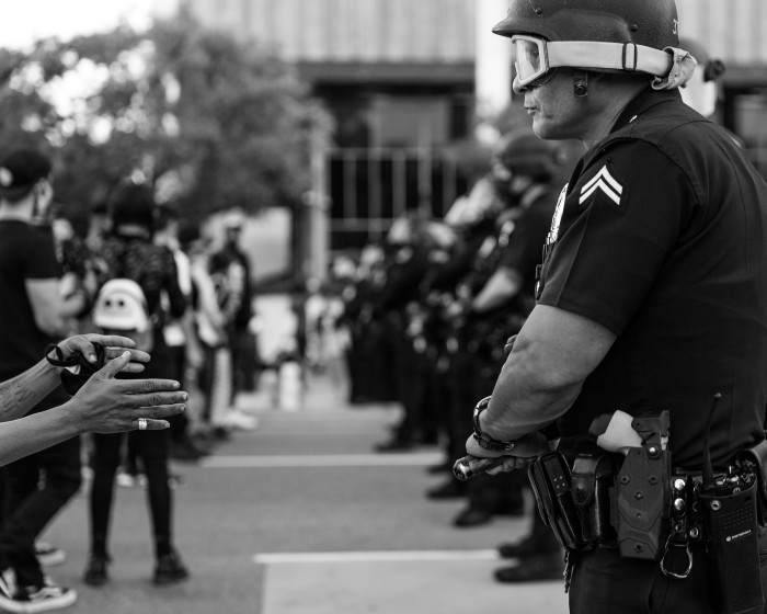 Los Angeles, May 27. Police officers in riot gear line up